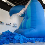 "Jaimes Mayhew, ""The Wave of Mutilation"" (foreground) and ""Postcards from Samesies Island"" (background)"